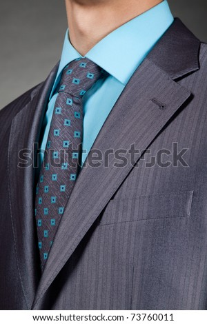 closeup businessman suit over gray background - stock photo
