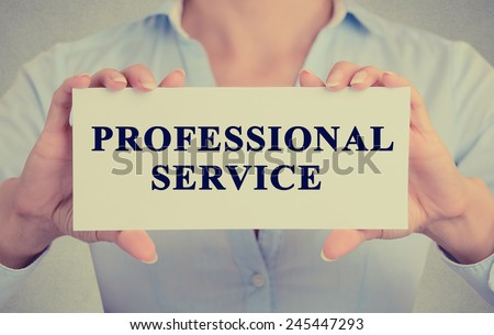 Closeup businesswoman hands holding Professional service sign card towards you, vintage retro filter effect toned image  - stock photo
