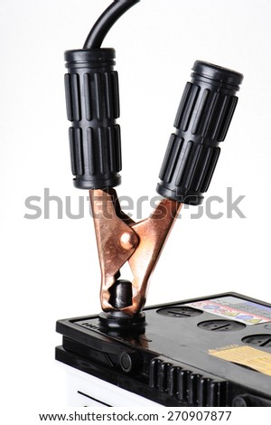 closeup car battery with jumper cable - stock photo