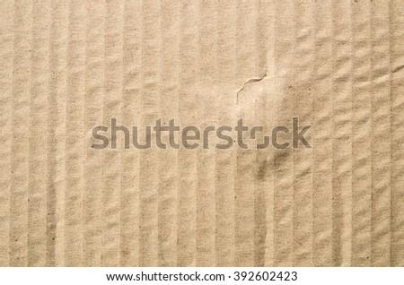 Closeup Cardboard Texture, brown corrugated cardboard sheet background - stock photo