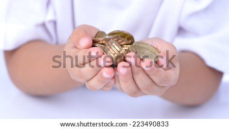 closeup child's hands holding world coins isolated on white background, human hands and saving concepts - stock photo