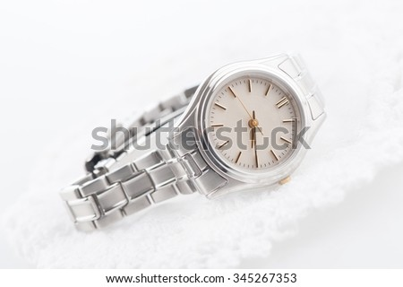 closeup classic woman wristwatch with stainless steel bracelet - stock photo