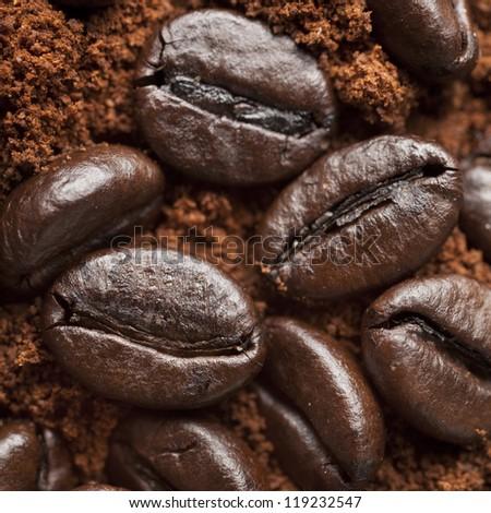 Closeup coffee beans at roasted coffee heap. Coffee bean on macro ground coffee background. Arabic roasting coffee - ingredient of hot beverage. - stock photo