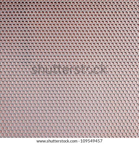 Closeup copper metal plate covered punched aluminum - stock photo