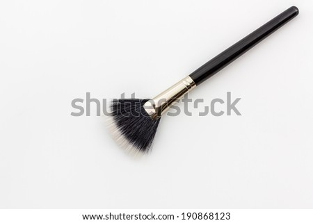 Closeup Cosmetic brush on the white background. - stock photo