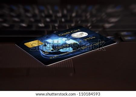 closeup credit card on computer keyboard - stock photo