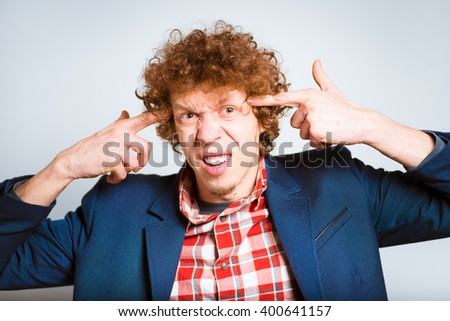 closeup curly man outraged, isolated on background - stock photo