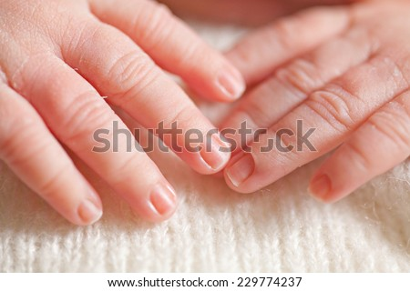 Closeup cute baby hands - stock photo