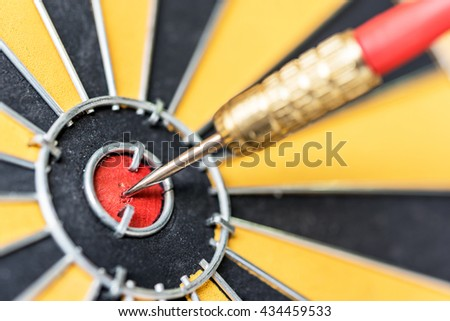 Closeup dart target with arrow on bullseye, Goal target success business investment financial strategy concept, abstract background - stock photo