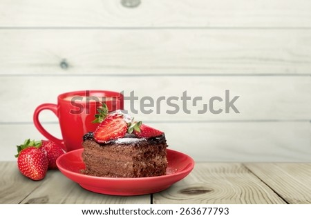 Closeup. Delicious chocolate cake with cream and berries and cup of coffee. - stock photo