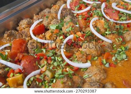 Closeup detail of a beef kofta curry on display at an indian restaurant - stock photo