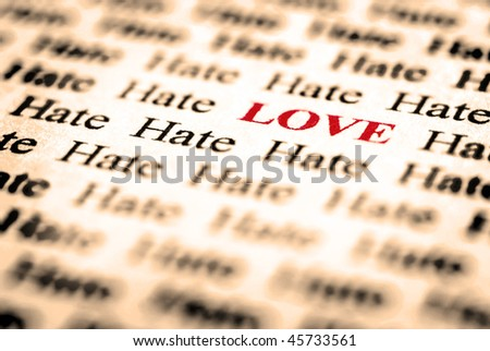 Closeup detail of black and white words with red word love - stock photo