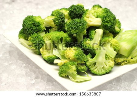 closeup detail of boiled broccoli vegetable on plate - stock photo