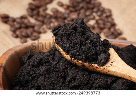 closeup detail of coffee ground in wooden bowl - stock photo