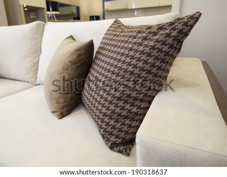 Closeup detail of cushions on sofa in living room - stock photo