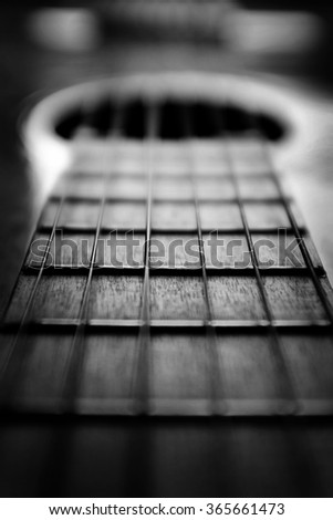 Closeup detail of guitar strings for playing music - stock photo