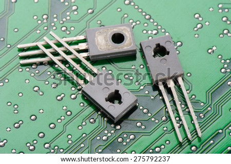 Closeup detail of transistors on circuit board - stock photo