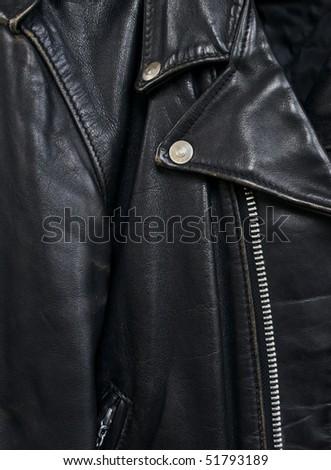 closeup detail of vintage black leather biker jacket - stock photo