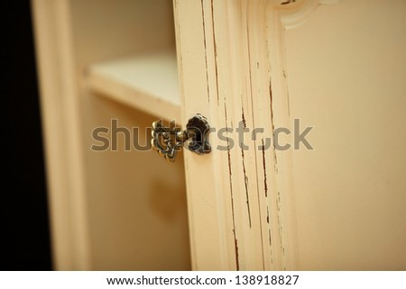 Closeup detail of vintage wooden dresser - stock photo