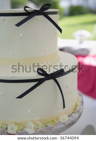 Closeup detail of wedding cake on reception table - stock photo
