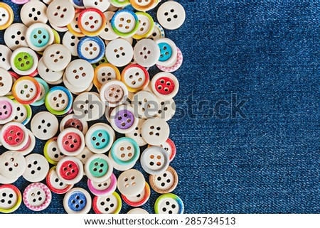 Closeup different Buttons with blue jeans background - stock photo
