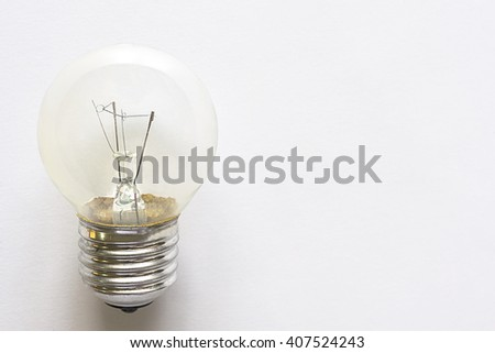 Closeup electronic bulb lamp on white background with copy space, idea or energy concept - stock photo