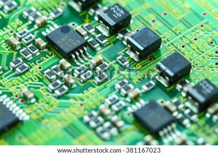 Closeup electronic circuit board background - stock photo