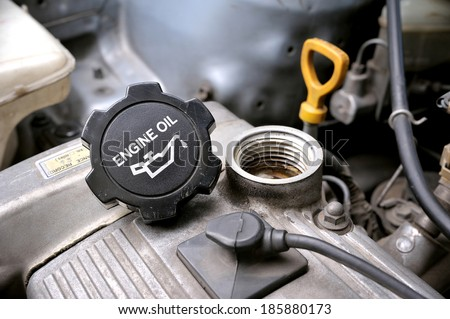 closeup engine oil cap in engine room of old car - stock photo