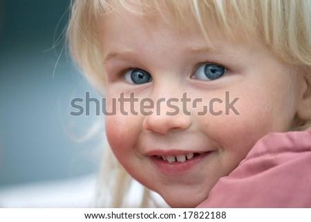 closeup face of beautiful smiling grey-eyed infant girl - stock photo
