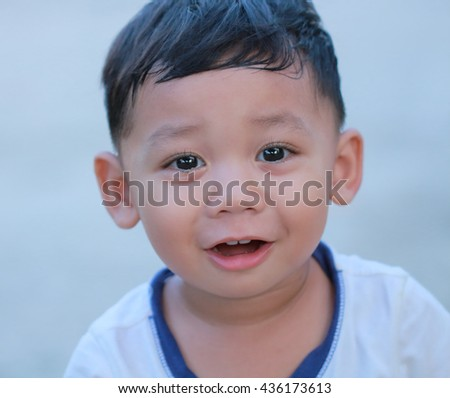 Closeup face young boy with cute smile . - stock photo