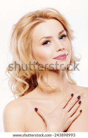 Closeup fashion portrait of beautiful model with clean fresh skin, nude makeup and pink lips. Inside - stock photo