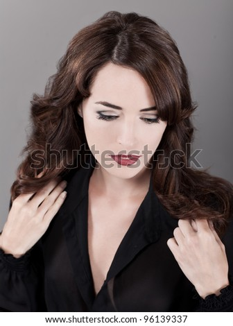 Closeup fashion portrait of sensuous woman isolated on gray background - stock photo