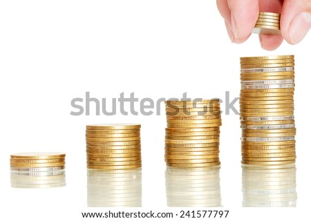 closeup finger put coins to coin stack,saving concept on white background - stock photo