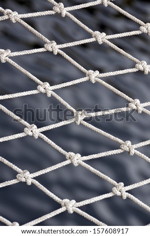 Closeup fishnet on sea background.  - stock photo