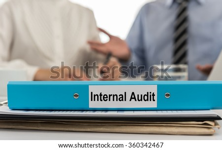 Closeup folder Internal Audit with Auditors give recommendations to the Manager in background. selective focus. - stock photo