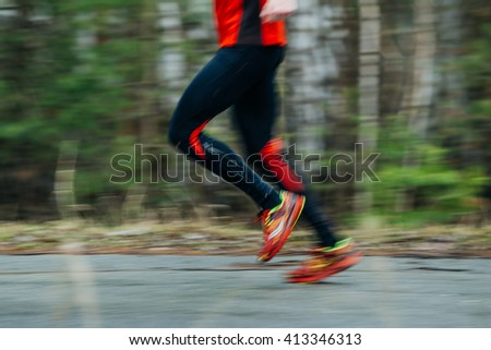 closeup foot of  runner men running along road in Park. Motion blur - stock photo