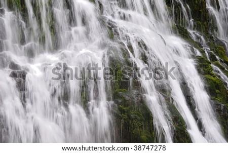 Closeup fragment of a powerful waterfall. - stock photo