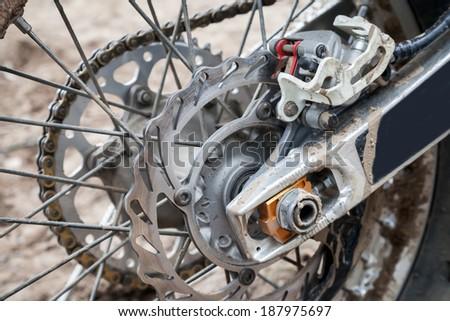 Closeup fragment of rear sport motocross bike wheel with brake - stock photo