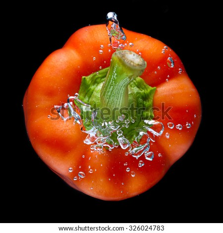 Closeup Fresh Red Bell Pepper Splash in Water on Black Background. - stock photo