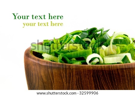 Closeup from wooden dish with leek on white background - stock photo