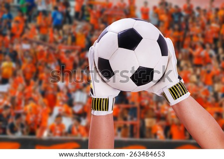 closeup goalkeeper super save on orange supporter - stock photo