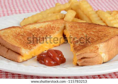 closeup grilled cheese with ketchup focus on ketchup - stock photo