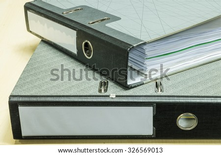 Closeup group of document file on wood desk background - stock photo