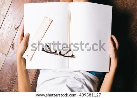 Closeup hand open book for reading concept - stock photo