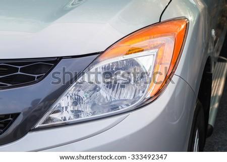 Closeup headlights of car  - stock photo