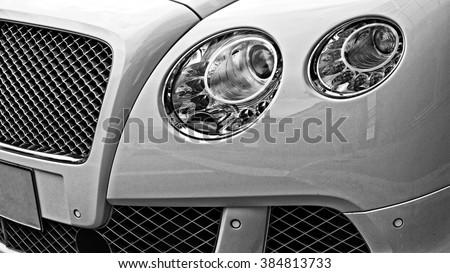 Closeup headlights of luxury car. Car exterior detail. - stock photo