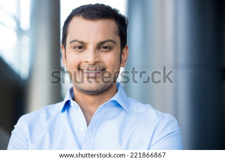 Closeup headshot portrait, happy handsome business man, smiling, in blue shirt,confident and friendly on isolated office interior background. Corporate success - stock photo