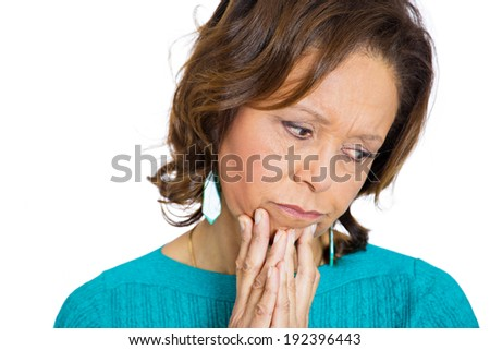 Closeup headshot, portrait sad, alone, dark, gloomy, frustrated, stressed, senior, mature woman bending head down, having bad nightmare day. Negative emotions, facial expressions, feelings, reaction - stock photo
