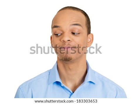 Closeup headshot portrait, young adult man who is looking to side, envious, eyeing someone stuff, isolated white background. Negative human emotion facial expression feelings, body language. - stock photo