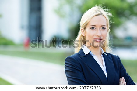 Closeup headshot portrait, young beautiful blonde business woman, confident lawyer, smiling isolated corporate office background. Positive human emotions, facial expressions, attitude, life perception - stock photo